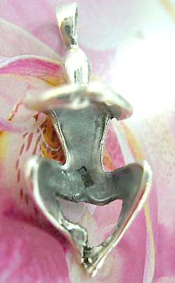 925. Thailand made solid sterling silver charm pendant with man in embrassing position design