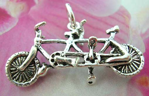925. Thailand made solid sterling silver charm pendant in twin bicycle design